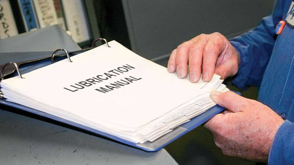 A lubrication manual of procedures in a three-ring binder kept at a plant.
